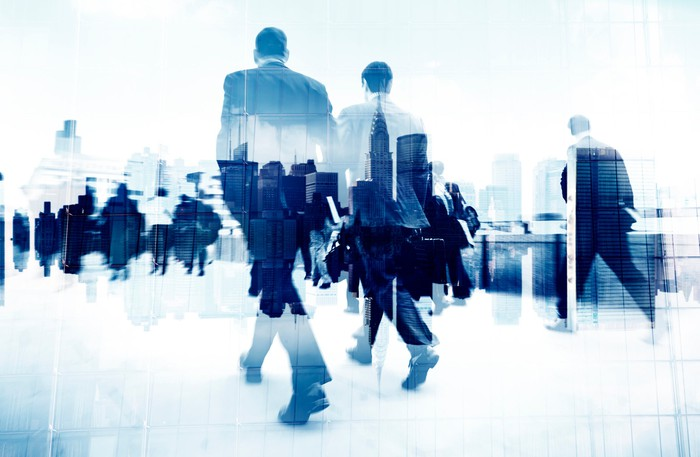 Image of men in suits fading and walking away