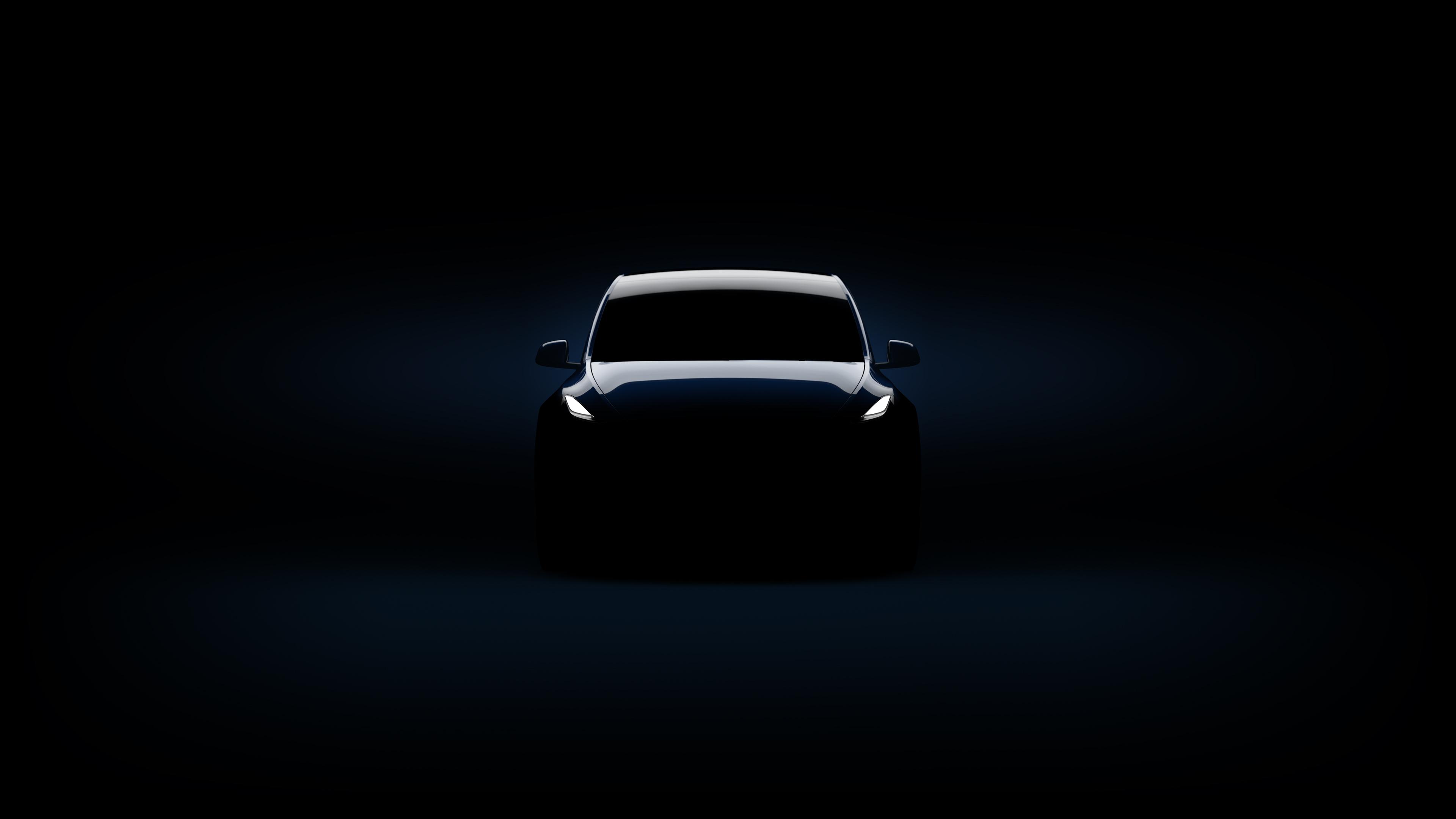 A Tesla Model Y in a dark room