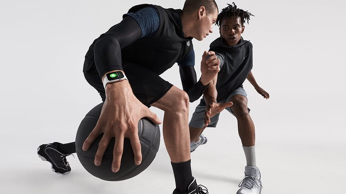 People playing basketball while wearing Apple Watch
