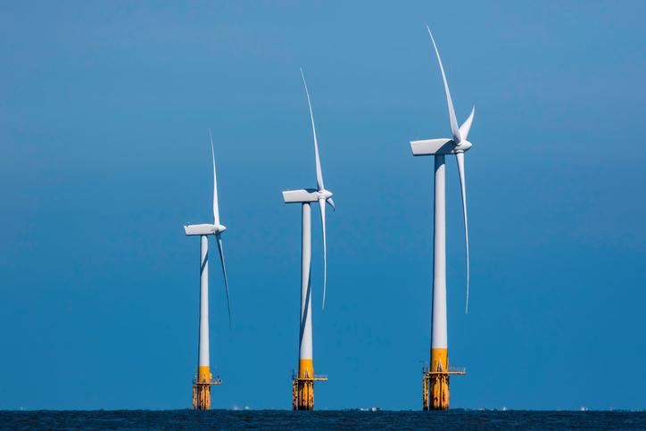 Three offshore wind turbines.