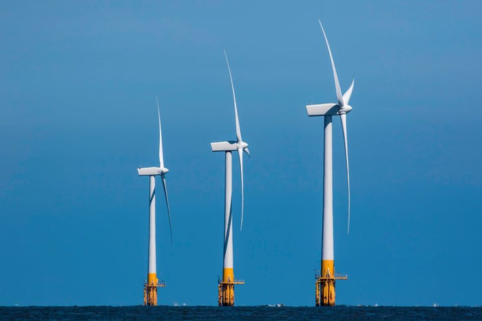 Three offshore wind turbines.