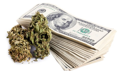 dry-marijuana-flower-and-stack-of-cash-getty