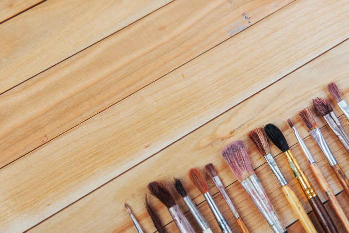 Various artist paintbrushes on a table.