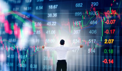 Man with arms outstretched in front of stock chart going up