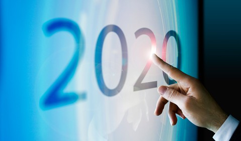 Finger touching 2020 on touchscreen