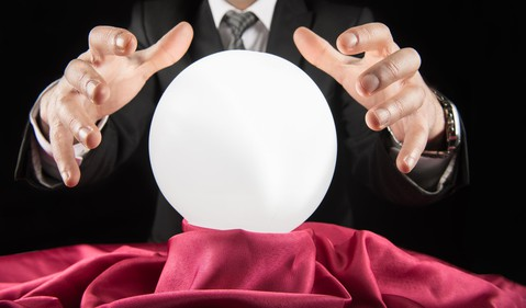 Businessman looking into crystal ball