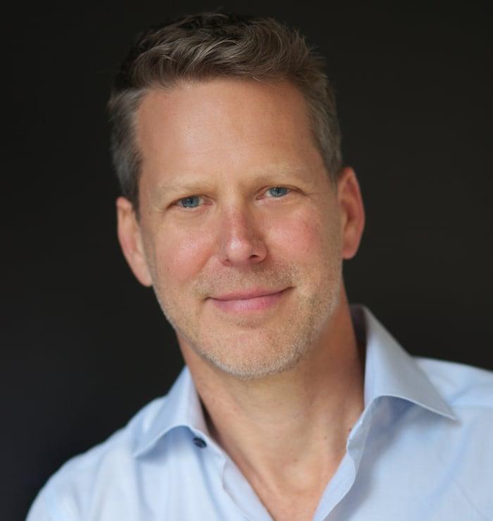 A headshot of Tim Stone.