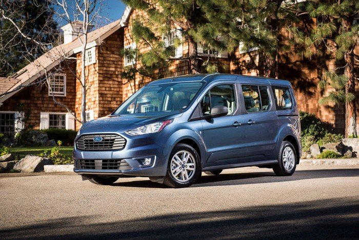 A blue 2019 Ford Transit Connect in Wagon trim, with seating for five passengers.