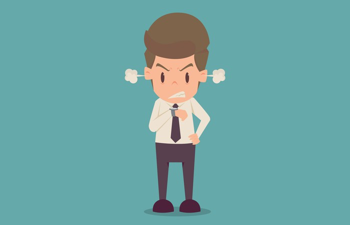 Cartoon of an angry businessman looking at his watch with steam coming out of his ears
