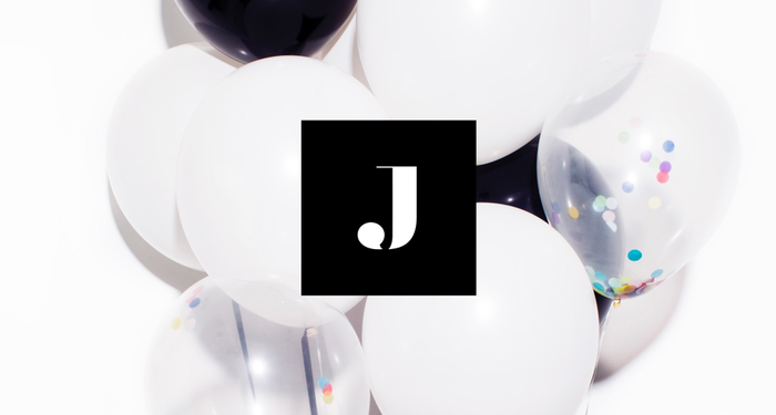 "The Jetblack ""J"" logo in front of some balloons."
