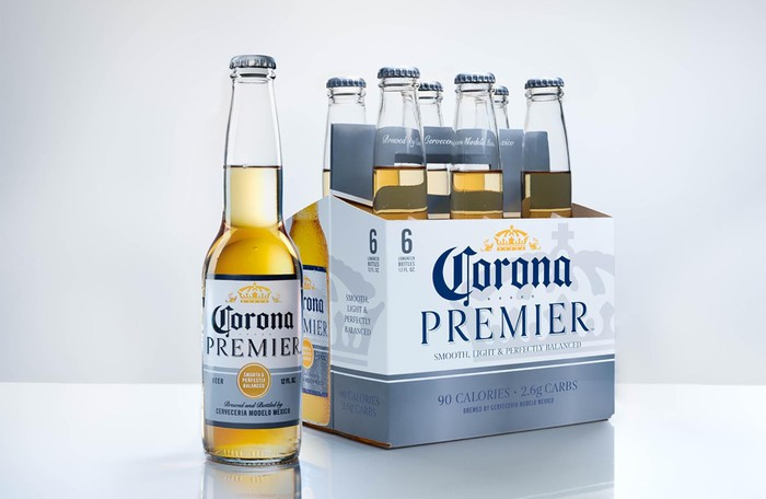 Bottle and six-pack of Corona Premier beer