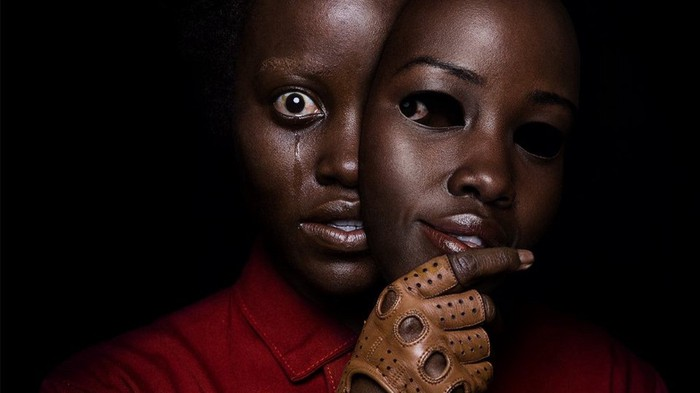A poster from Jordan Peele's movie 'Us' shows a woman removing a mask.