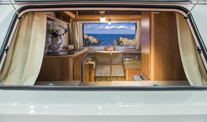 A glimpse of the ocean through the interior of a modern recreational vehicle.