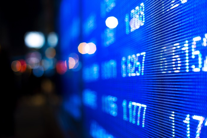 Stock tickers on a digital screen.