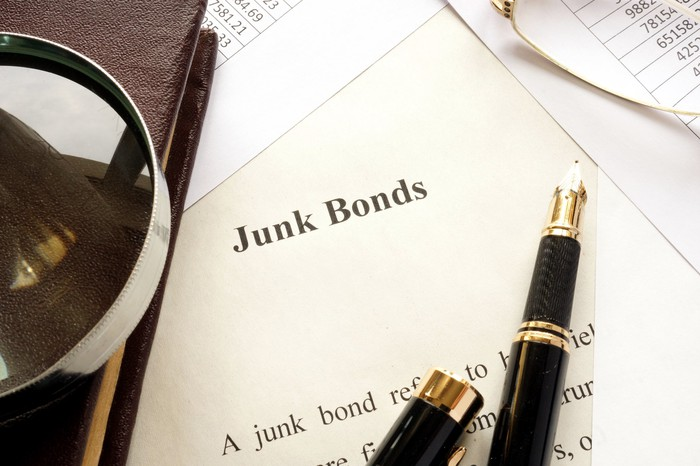 Document titled Junk Bonds with open pen resting on it