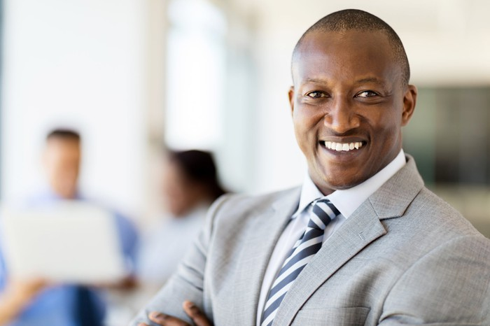 Smiling man wearing a business suit.