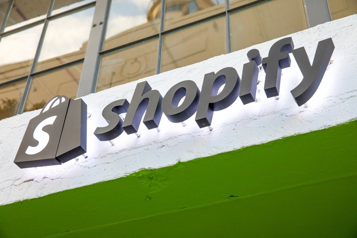 """A sign reading """"Shopify"""" with the company's logo next to it, on the outside of its new Los Angeles location."""