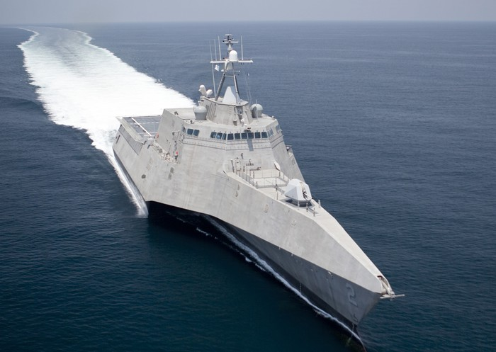 The USS Independence cuts through the water.
