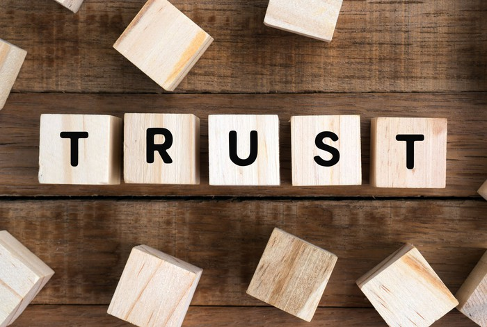 """The word """"trust"""" spelled out on wooden blocks."""
