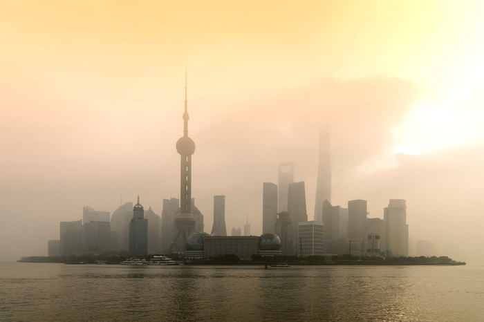 Shanghai skyline with pollution fog