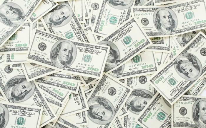 A scattered pile of hundred-dollar bills