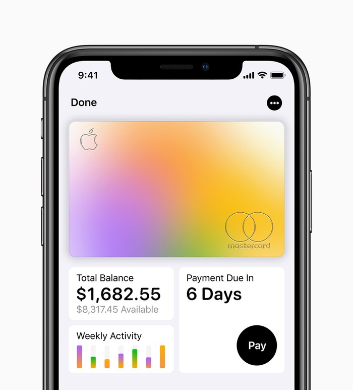 An iPhone showing features from the Apple Card including total balance, weekly activity, and when the payment is due.
