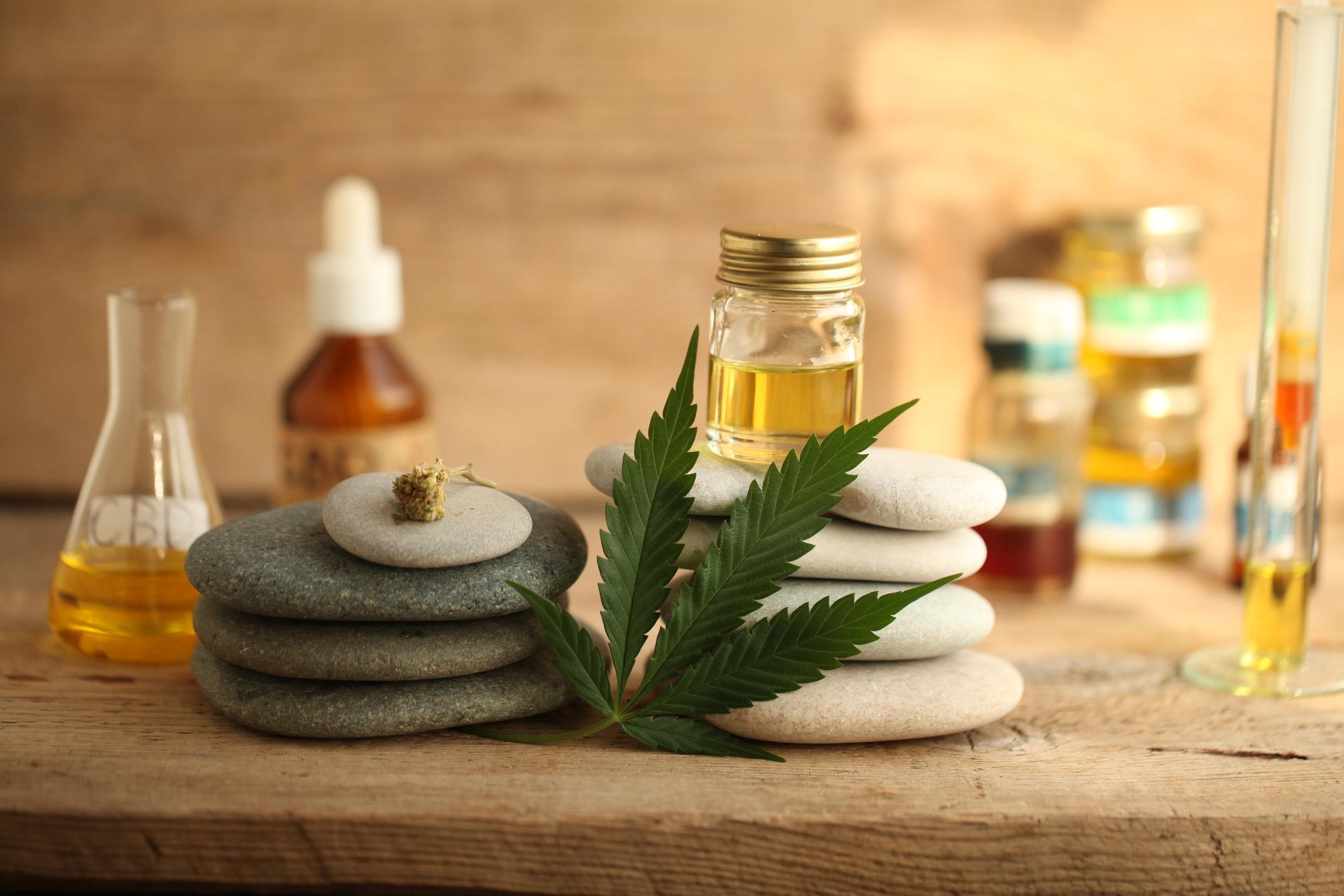 Bottles of cannabidiol oil with marijuana leaf