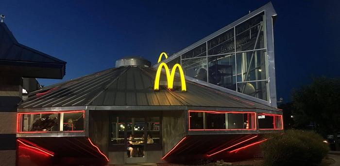 Saucer-shaped restaurant building with McDonald's logo.