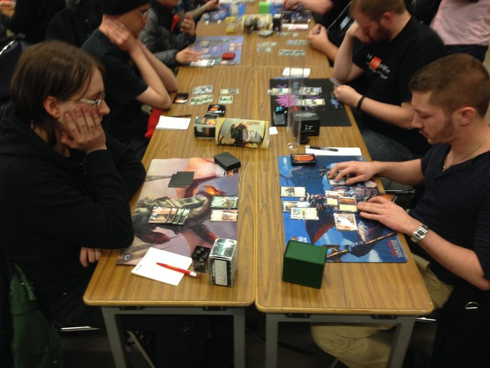 Players competing in a Magic: The Gathering tournament