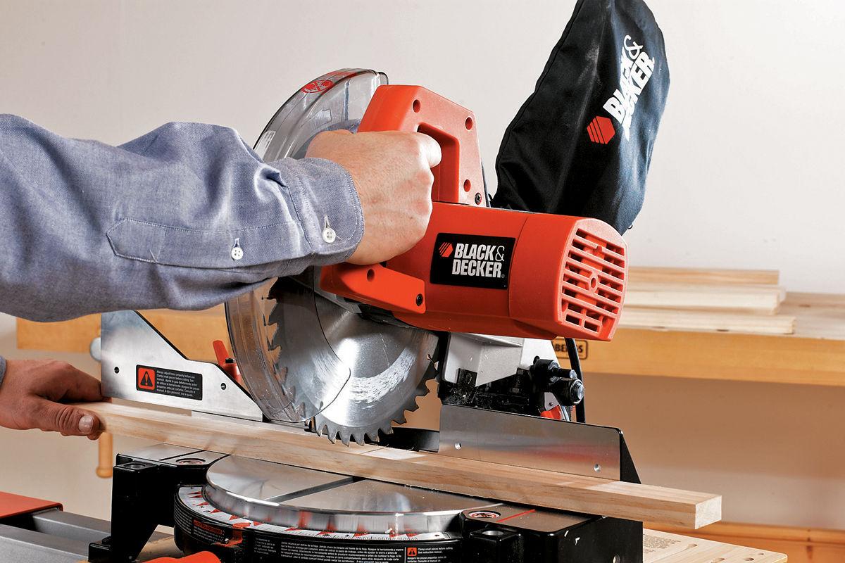 Man using Black & Decker chop saw