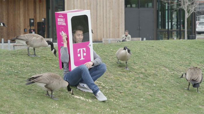 A person wears a T-Mobile Phone BoothE.