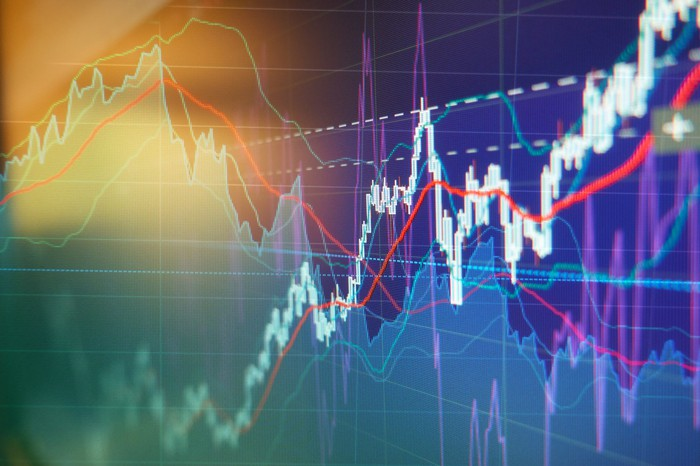 Rising stock graphs on colorful background.