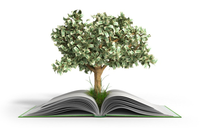 A money tree growing out of a book.