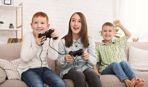 kids playing video game getty