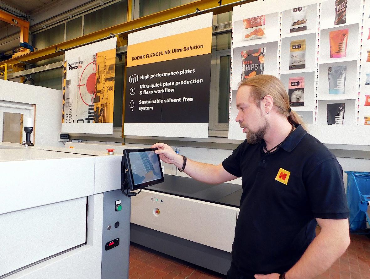 Man using printing process machine