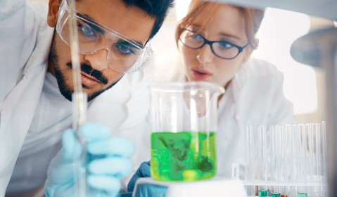 Male and female scientists in lab (2)