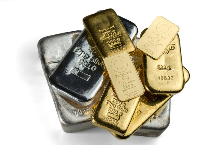 Silver and gold bars piled on top of each other.