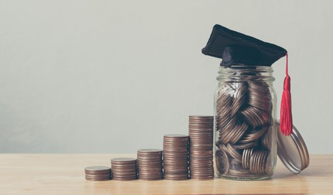 Stack of Coins Leading to Graduation Cap