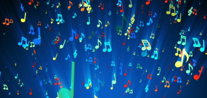 Lots of brightly colored music notes on a blue background
