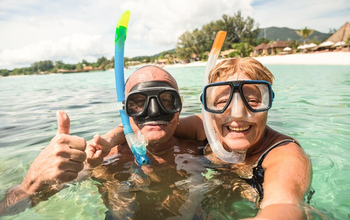 Senior couple in the water with snorkeling gear