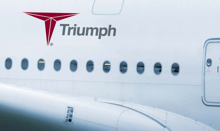 Wide-body aircraft with Triumph logo on the side.