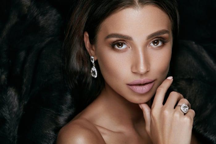 A woman wearing luxury jewelry.