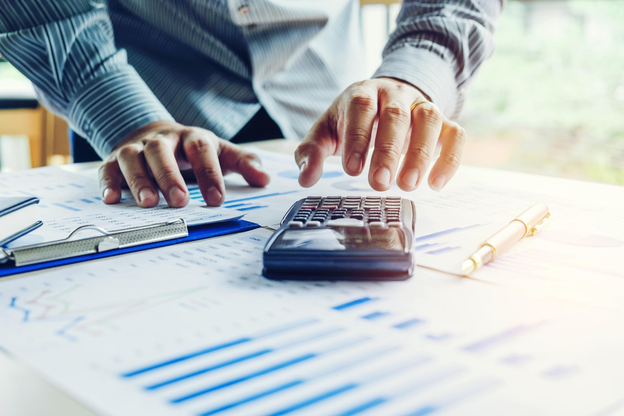 A person calculating financial data.