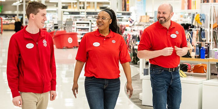 Three workers in red Target shirts.