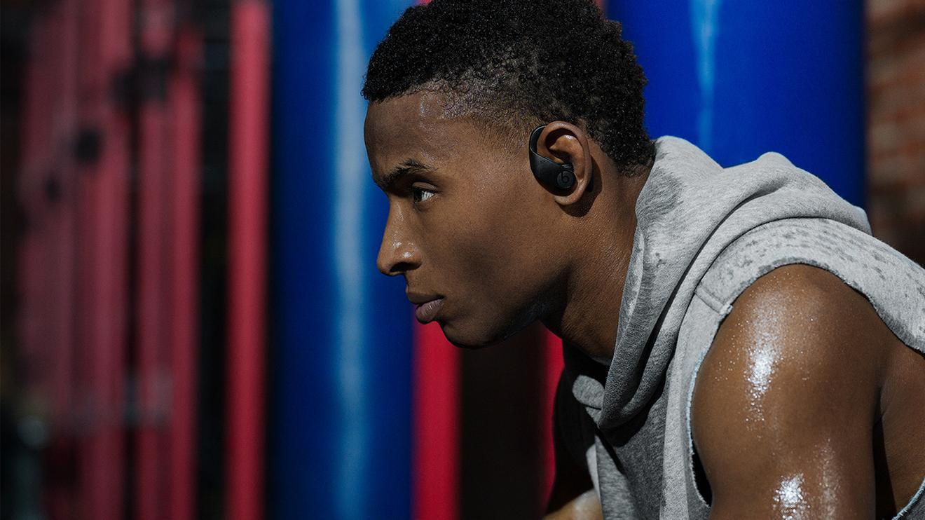 A man wearing Powerbeats Pro headphones