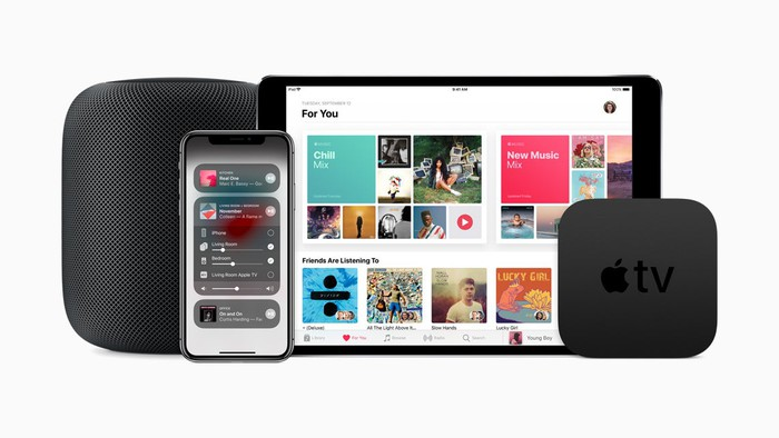 Apple Music interface displayed on an iPad, next to an iPhone, an Apple TV, and a HomePod