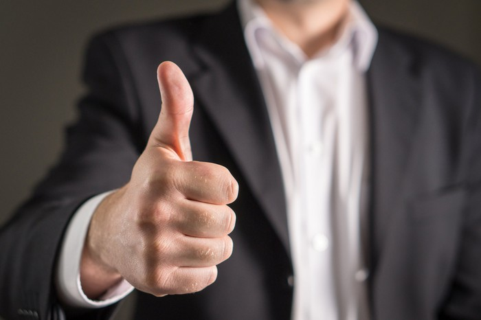 Businessman with one thumb up