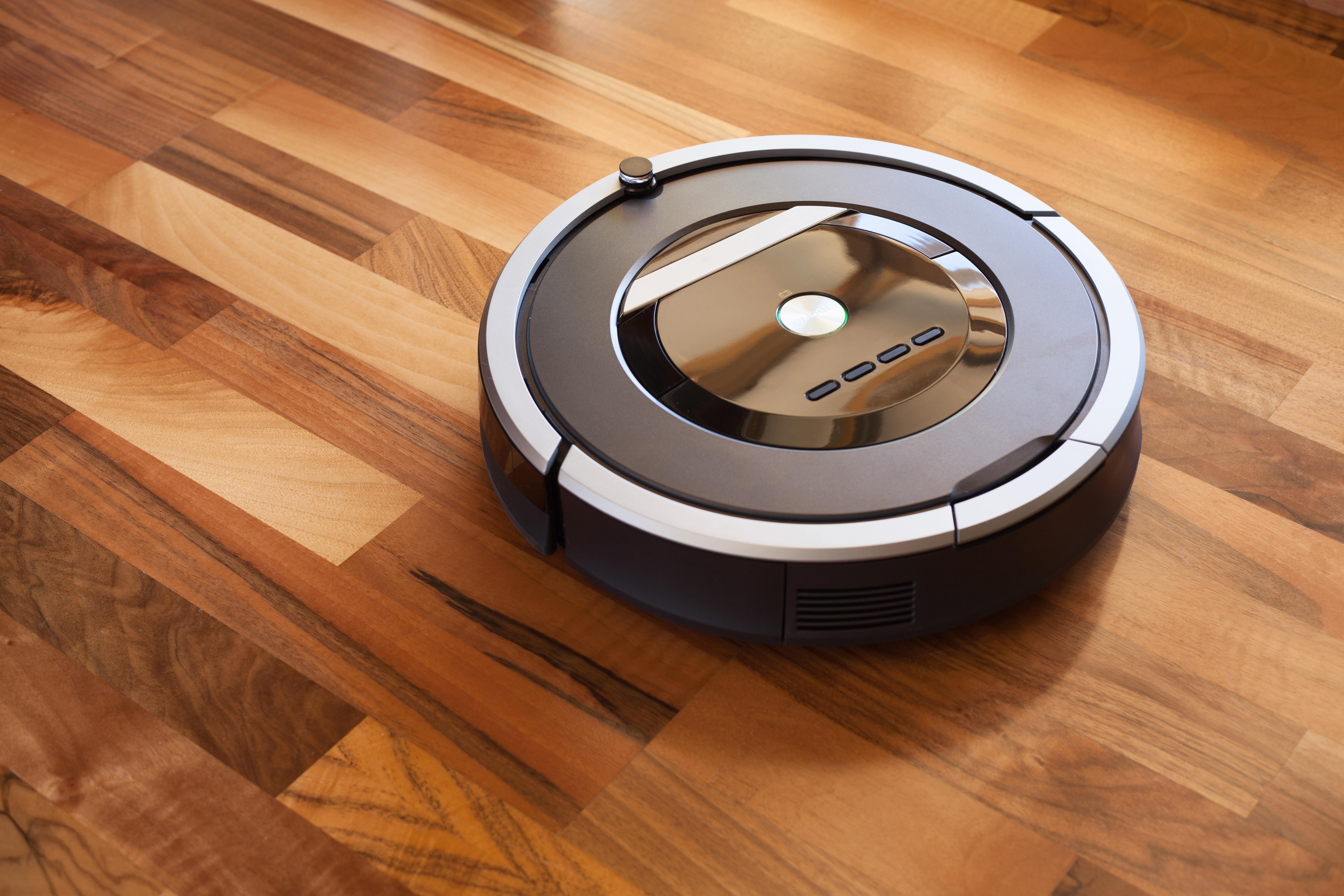 Robotic vacuum cleaner on a hardwood floor.