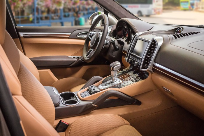 A luxury car interior in brown leather.
