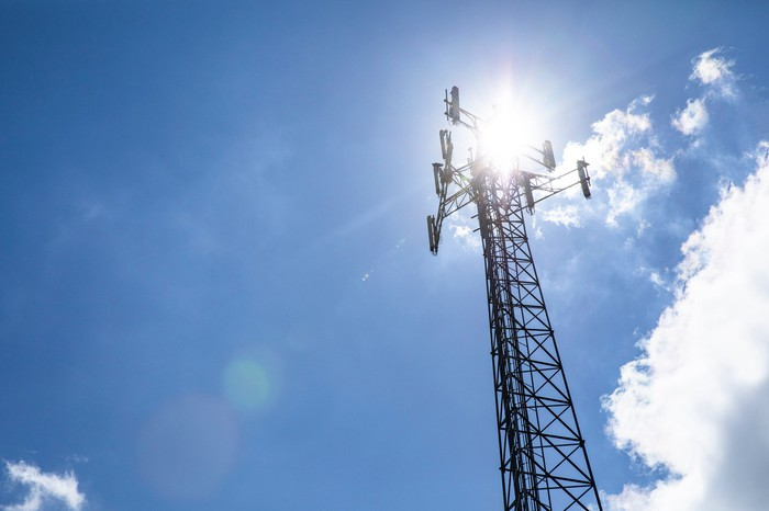 A wireless tower against a blue sky